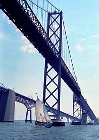 SIlboat under Chesapeake Bay Bridge